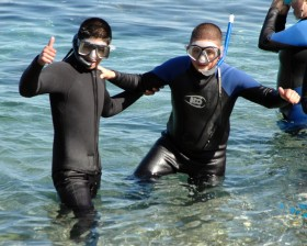 Campers encourage each other to overcome their inhibitions to the unfamiliar world of snorkeling!
